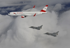 Two Austrian Eurofighter Typhoons are seen here escorting an Austrian Airlines  Boeing 767-300ER
