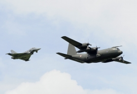 Austrian Airforce Eurofighter intercepting C130