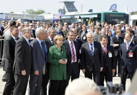 Chancellor Angela Merkel gets a guided tour around ILA 2010 in Berlin